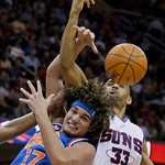 Phoenix Suns' Grant Hill (33) and Cleveland Cavaliers' Anderson Varejao (17), of Brazil, battle for a loose ball in the second quarter in an NBA basketball game Wednesday, Dec. 2, 2009, in C …