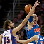 Cleveland Cavaliers' Zydrunas Ilgauskas, upper right, of Lithuania, and Phoenix Suns' Robin Lopez (15) battle for a loose ball in the first quarter of an NBA basketball game Wednesday, Dec.  …