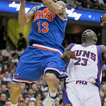 Cleveland Cavaliers' Delonte West (13) looks for help from teammates against Phoenix Suns' Jason Richardson (23) in the second quarter in an NBA basketball game Wednesday, Dec. 2, 2009, in C …