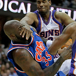 Phoenix Suns' Jarron Collins, top, fouls Cleveland Cavaliers' Shaquille O'Neal (33) in the second quarter in an NBA basketball game Wednesday, Dec. 2, 2009, in Cleveland. (AP Photo/Tony Deja …