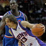 Phoenix Suns' Steve Nash (13) drives past Cleveland Cavaliers' J.J. Hickson (21) in the first quarter in an NBA basketball game Wednesday, Dec. 2, 2009, in Cleveland. (AP Photo/Tony Dejak)