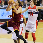 Cleveland Cavaliers forward Luke Walton (4) shoots past Washington Wizards forward Jan Vesely (24), of the Czech Republic, in the second half of an NBA basketball game, Wednesday, Dec. 26, 2 …