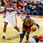 Cleveland Cavaliers guard Kyrie Irving saves the ball from going out of bounds with Washington Wizards forward Martell Webster behind in the second half of an NBA basketball game, Wednesday, …