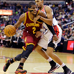 Cleveland Cavaliers guard Kyrie Irving (2) drives against Washington Wizards guard Garrett Temple in the first half of an NBA basketball game, Wednesday, Dec. 26, 2012, in Washington. (AP Ph …
