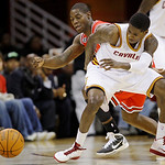 Chicago Bulls' Ronnie Brewer, left, and Cleveland Cavaliers' Manny Harris, front, battle for a loose ball in the first half in an NBA basketball game Wednesday, Dec. 8, 2010, in Cleveland. ( …