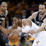 San Antonio Spurs' Manu Ginobili, right, tries to knock the ball loose from Cleveland Cavaliers' Wayne Ellington during the first quarter of an NBA basketball game Wednesday, Feb. 13, 2013,  …
