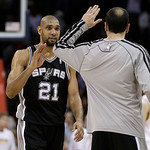 San Antonio Spurs' Tim Duncan, left, is congratulated by Manu Ginobili after the Spurs defeated the Cavaliers 96-95 in an NBA basketball game Wednesday, Feb. 13, 2013, in Cleveland. (AP Phot …