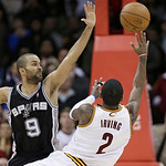 Cleveland Cavaliers' Kyrie Irving (2) misses a shot at the close of the game as San Antonio Spurs' Tony Parker (9) defends late in the fourth quarter of an NBA basketball game Wednesday, Feb …