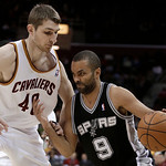 San Antonio Spurs' Tony Parker (9) drives past Cleveland Cavaliers' Tyler Zeller (40) during the first quarter of an NBA basketball game Wednesday, Feb. 13, 2013, in Cleveland. (AP Photo/Ton …