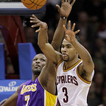 Cleveland Cavaliers' Ramon Sessions (3) passes the ball under pressure from Los Angeles Lakers' Lamar Odom (7) in the fourth quarter of an NBA basketball game in Cleveland on Wednesday, Feb. …