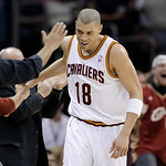 Cleveland Cavaliers' Anthony Parker (18) slaps hands with fans after hitting a basket at the buzzer against the Los Angeles Lakers at the end of the second quarter in their NBA basketball ga …