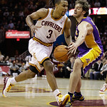 Cleveland Cavaliers' Ramon Sessions (3) drives to the basket against Los Angeles Lakers' Pau Gasol in the second half of an NBA basketball game in Cleveland on Wednesday, Feb. 16, 2011. The  …