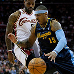 Denver Nuggets forward Carmelo Anthony, right, tries to get past Cleveland Cavaliers forward LeBron James in the first quarter in an NBA basketball game Thursday, Feb. 18, 2010, in Cleveland …