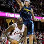 Denver Nuggets center Chris Andersen (11) tries to block a shot by Cleveland Cavaliers center Shaquille O'Neal (33) in the second quarter in an NBA basketball game Thursday, Feb. 18, 2010, i …