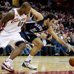Memphis Grizzlies center Hamed Haddadi, (15) from Iran, and Cleveland Cavaliers' Darnell Jackson (00) battle for a loose ball in the fourth quarter in an NBA basketball game Tuesday, Feb. 2, …