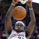 Cleveland Cavaliers' LeBron James dunks against Memphis Grizzlies in the second quarter in an NBA basketball game Tuesday, Feb. 2, 2010, in Cleveland. (AP Photo/Tony Dejak)