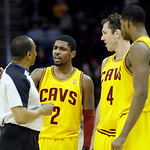 Cleveland Cavaliers' Kyrie Irving (2) talks with referee Eddie F. Rush as Luke Walton (4) and Tristan Thompson listen in during an NBA basketball game against the New Orleans Hornets Wednesd …
