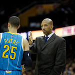 New Orleans Hornets head coach Monty Williams talks to Austin Rivers (25) during an NBA basketball game against the Cleveland Cavaliers Wednesday, Feb. 20, 2013, in Cleveland. (AP Photo/Mark …