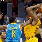 Cleveland Cavaliers' Tristan Thompson, right, is fouled by New Orleans Hornets' Roger Mason Jr. (8) during the fourth quarter of an NBA basketball game Wednesday, Feb. 20, 2013, in Cleveland …