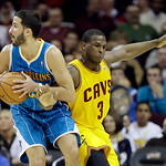 Cleveland Cavaliers' Dion Waiters (3) defends New Orleans Hornets' Greivis Vasquez, from Venezuela,  in an NBA basketball game Wednesday, Feb. 20, 2013, in Cleveland. (AP Photo/Mark Duncan)