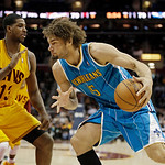 New Orleans Hornets' Robin Lopez, drices the baseline on Cleveland Cavaliers' Tristan Thompson in an NBA basketball game Wednesday, Feb. 20, 2013, in Cleveland. (AP Photo/Mark Duncan)