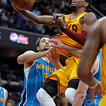 Cleveland Cavaliers' Kyrie Irving lays in a shot against New Orleans Hornets' Ryan Anderson during the third quarter of an NBA basketball game Wednesday, Feb. 20, 2013, in Cleveland. Irving  …