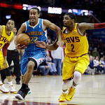 New Orleans Hornets' Brian Roberts (22) drives to the basket between Cleveland Cavaliers' Wayne Ellington, left, and Kyrie Irving (2) during the fourth quarter of an NBA basketball game Wedn …