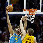 New Orleans Hornets' Robin Lopez (15) shoots against Cleveland Cavaliers' Tyler Zeller (40) in an NBA basketball game Wednesday, Feb. 20, 2013, in Cleveland. (AP Photo/Mark Duncan)