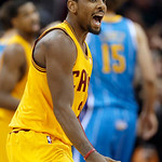 Cleveland Cavaliers' Kyrie Irving celebrates after making a 3-point shot against the New Orleans Hornets in the fourth quarter of an NBA basketball game Wednesday, Feb. 20, 2013, in Clevelan …