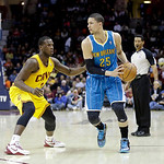 New Orleans Hornets' Austin Rivers (25) works against Cleveland Cavaliers' Dion Waiters in an NBA basketball game Wednesday, Feb. 20, 2013, in Cleveland. (AP Photo/Mark Duncan)