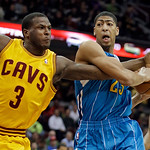 Cleveland Cavaliers' Dion Waiters (3) fouls New Orleans Hornets' Anthony Davis during the first quarter of an NBA basketball game Wednesday, Feb. 20, 2013, in Cleveland. (AP Photo/Mark Dunca …