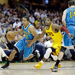 New Orleans Hornets' Brian Roberts (22) drives Cleveland Cavaliers' Kyrie Irving into a screen by Jason Smith (14) in an NBA basketball game Wednesday, Feb. 20, 2013, in Cleveland. (AP Photo …