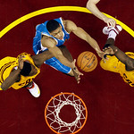 New Orleans Hornets' Anthony Davis, center, grabs a rebound against Cleveland Cavaliers' Tristan Thompson, left, and Dion Waiters during the second quarter of an NBA basketball game Wednesda …