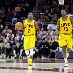 Cleveland Cavaliers' Kyrie Irving (2) calls a play as Tristan Thompson (13) trails in an NBA basketball game against the New Orleans Hornets Wednesday, Feb. 20, 2013, in Cleveland. (AP Photo …