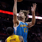 New Orleans Hornets' Robin Lopez (15) runs over Cleveland Cavaliers' Kyrie Irving on a shot in the fourth quarter of an NBA basketball game Wednesday, Feb. 20, 2013, in Cleveland. Lopez foul …