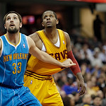 New Orleans Hornets' Ryan Anderson (33) boxes out Cleveland Cavaliers' C.J. Miles in an NBA basketball game Wednesday, Feb. 20, 2013, in Cleveland. (AP Photo/Mark Duncan)