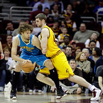 New Orleans Hornets' Robin Lopez goes up against Cleveland Cavaliers' Tyler Zeller in an NBA basketball game Wednesday, Feb. 20, 2013, in Cleveland. (AP Photo/Mark Duncan)