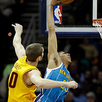 New Orleans Hornets' Anthony Davis, right, is fouled by Cleveland Cavaliers' Tyler Zeller in the first quarter of an NBA basketball game Wednesday, Feb. 20, 2013, in Cleveland. (AP Photo/Mar …