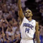 Orlando Magic guard Jameer Nelson points upward after hitting a three-point basket late in the second half of an NBA basketball game against the Cleveland Cavaliers in Orlando, Fla., Sunday, …