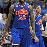 Cleveland Cavaliers forward LeBron James, left, reacts to a play as teammate Delonte West looks on during the second half of an NBA basketball game against the Orlando Magic in Orlando, Fla. …