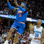 Cleveland Cavaliers guard Mo Williams (2) jumps to the basket in front of New Orleans Hornets forward David West (30) in the first quarter of an  NBA basketball game Tuesday, Feb. 23, 2010,  …