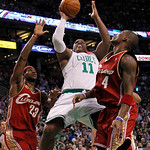 Boston Celtics' Glen Davis (11) tries to shoot between Cleveland Cavaliers' LeBron James (23) and Antawn Jamison (4) in the first quarter of an NBA basketball game, Thursday, Feb. 25, 2010,  …