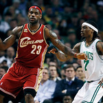 Cleveland Cavaliers' LeBron James (23) keeps the ball away from Boston Celtics' Marquis Daniels in the first quarter of an NBA basketball game, Thursday, Feb. 25, 2010, in Boston. (AP Photo/ …