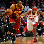 Chicago Bulls' Richard Hamilton, right, grabs the jersey of Cleveland Cavaliers' Wayne Ellington to stop him from a fast break during the first quarter of their NBA basketball game, Tuesday, …