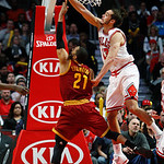 Chicago Bulls' Joakim Noah blocks a shot by Cleveland Cavaliers' Wayne Ellington during the second half of their NBA basketball game, Tuesday, Feb. 26, 2013, in Chicago. The Cavaliers won 10 …