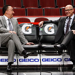 Chicago Bulls general manager Gar Forman, left, and executive vice president of basketball operations John Paxson talk before an NBA basketball game between the Bulls and the Cleveland Caval …