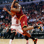 Chicago Bulls' Carlos Boozer (5) blocks the path to the basket from Cleveland Cavaliers' Tristan Thompson during the first quarter of their NBA basketball game, Tuesday, Feb. 26, 2013, in Ch …