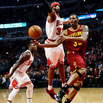 Cleveland Cavaliers' Alonzo Gee, right, makes a pass while being defended by Chicago Bulls' Richard Hamilton during the second quarter of their NBA basketball game, Tuesday, Feb. 26, 2013, i …