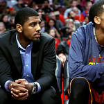 Cleveland Cavaliers' Kyrie Irving watches an NBA basketball game against the Chicago Bulls, Tuesday, Feb. 26, 2013, in Chicago. Irving sat the game out to rest his sore right knee. (AP Photo …