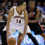Cleveland Cavaliers' Shaun Livingston (14) works against Toronto Raptors' Kyle Lowry during the fourth quarter of an NBA basketball game Wednesday, Feb. 27, 2013, in Cleveland. The Cavaliers …